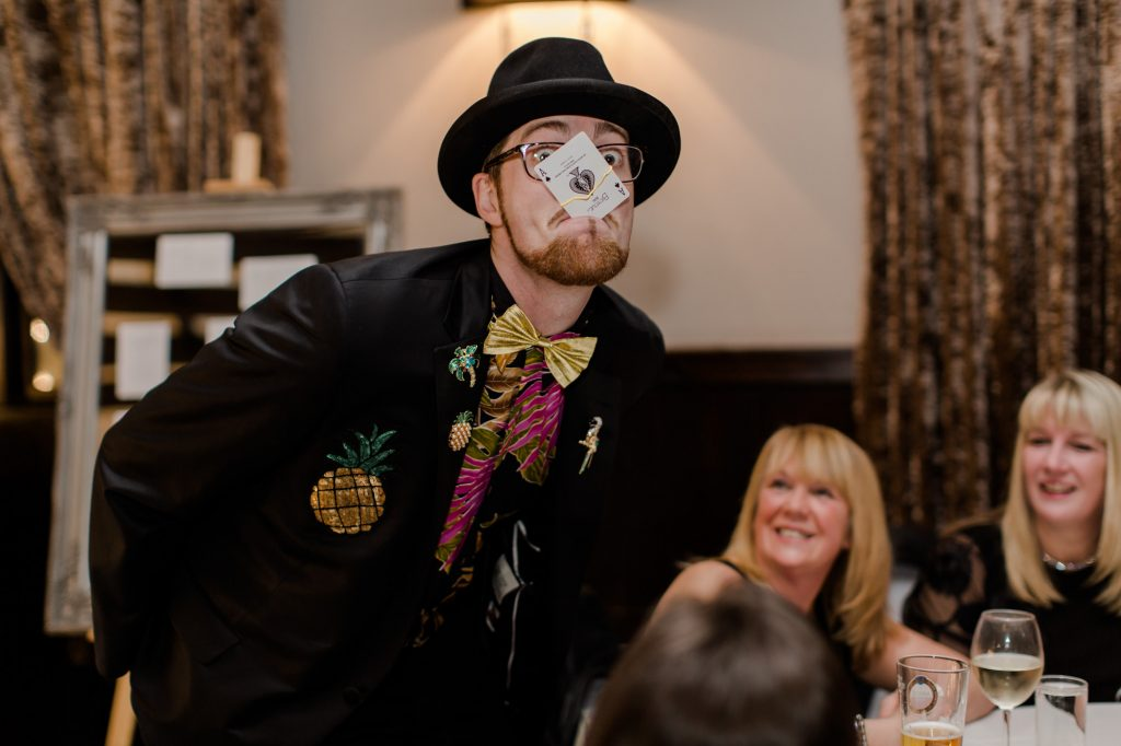 Magician Chris Cross entertaining guests