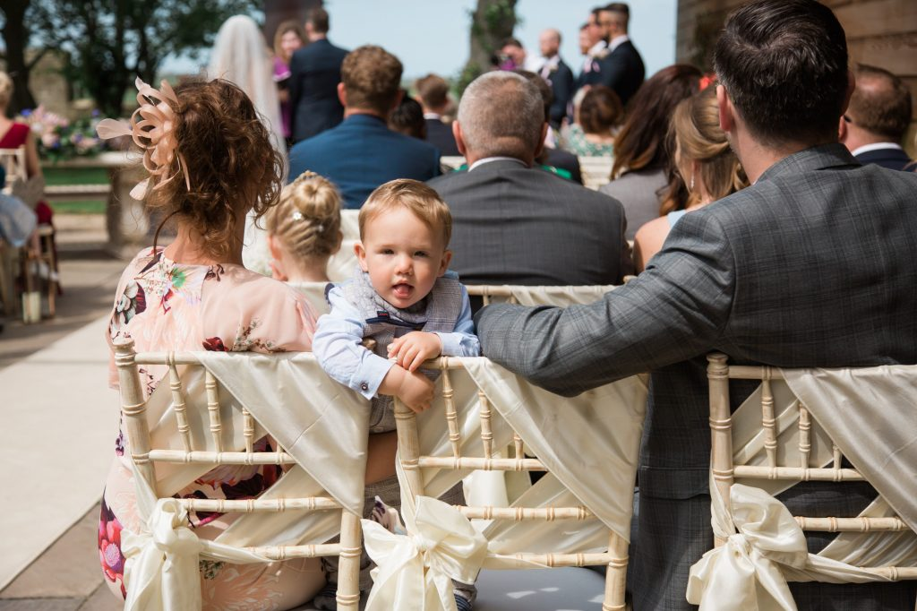 baby looking over mums shoulder during ceremony